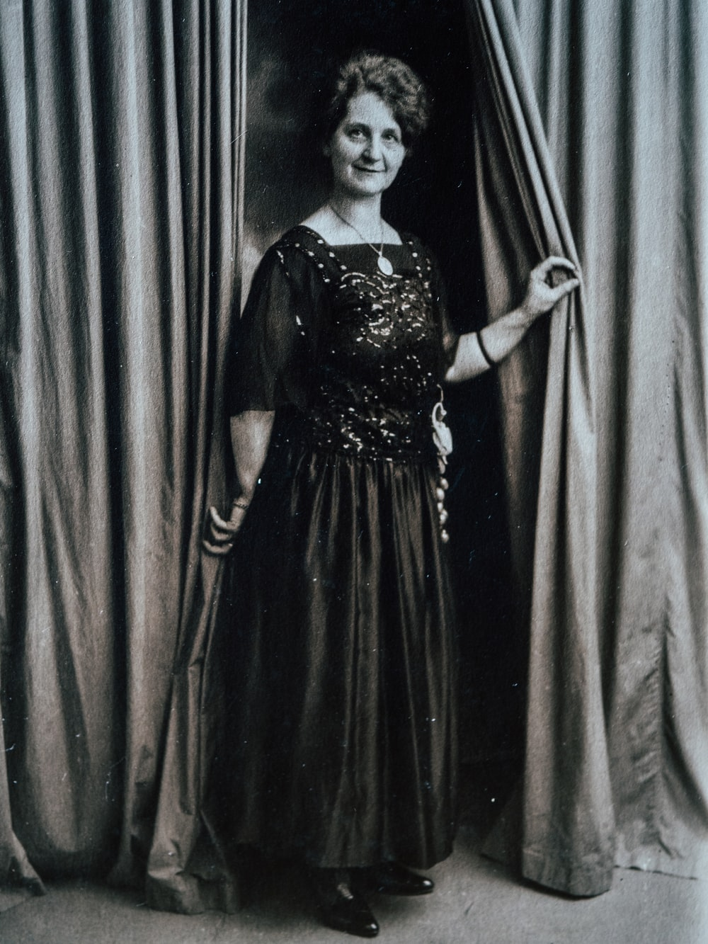 women's black elbow-sleeved maxi dress