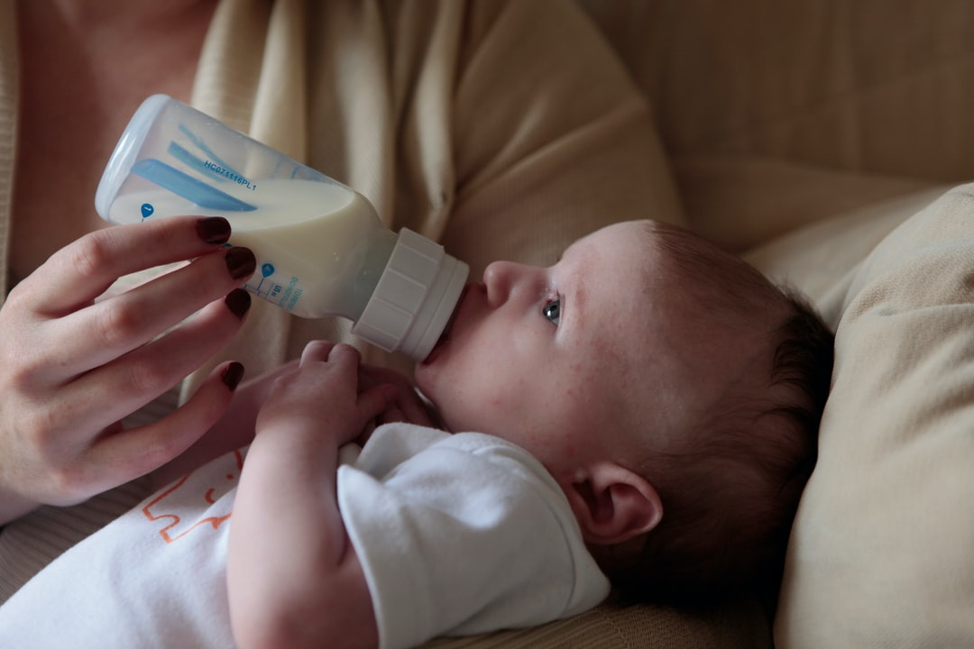 Baby feeding from a bottle