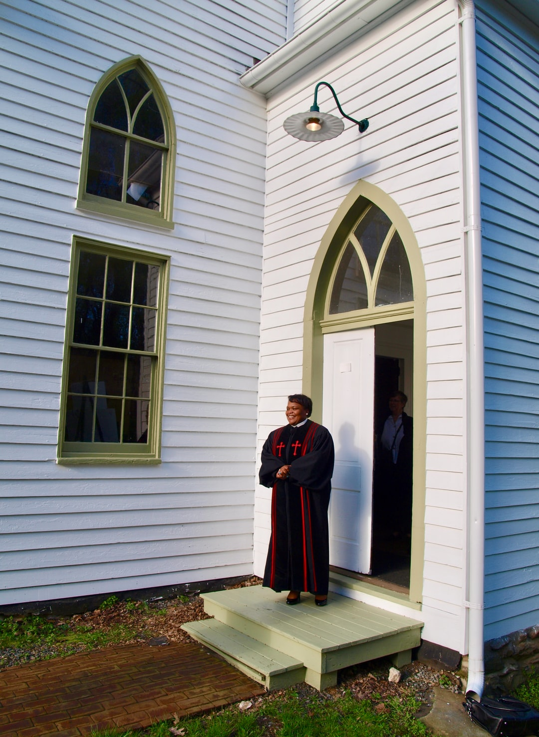 Pastor Michelle C. Thomas at Easter Sunrise Service, John Wesley Church, Waterford, Virginia 2019. Pastor Michelle C. Thomas is President of Loudoun County, Virginiua's NAACP.  She has gained recognition for her successful efforts to preserve African American burial sites in a rapidly developing county.  John Wesley Church, built by its African American congregation after the Civil War, is located in Waterford, a historic village on the National Registry of Historic Places.