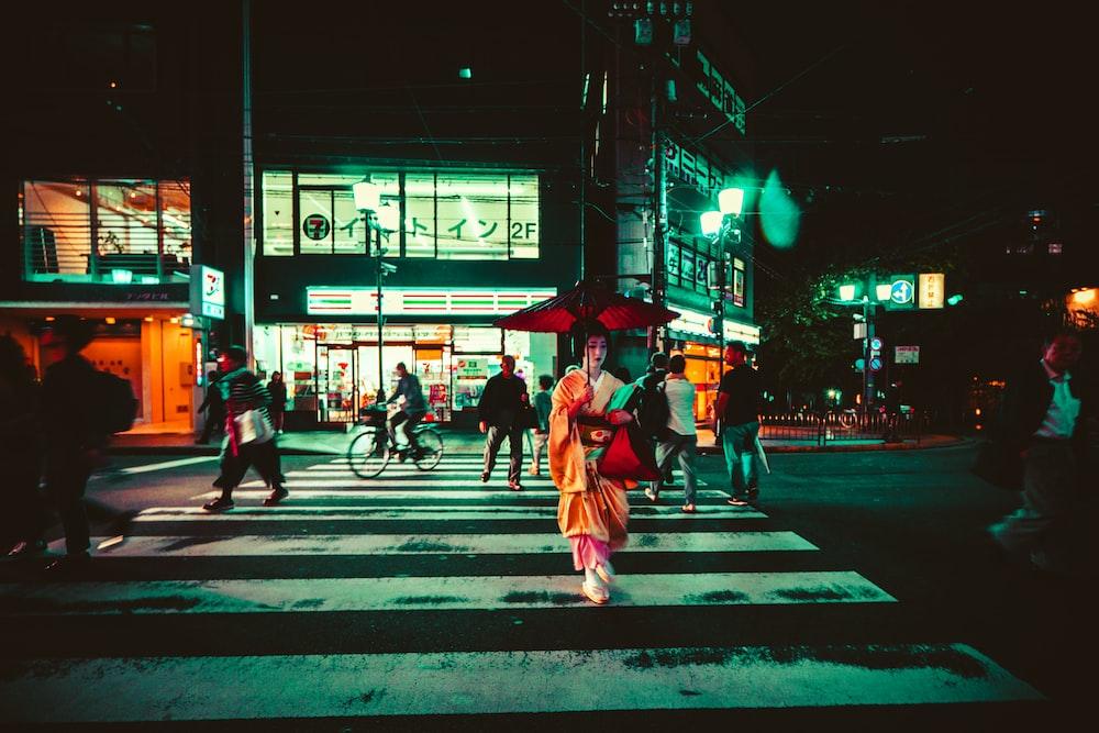 geisha crossing a pedestrian lane