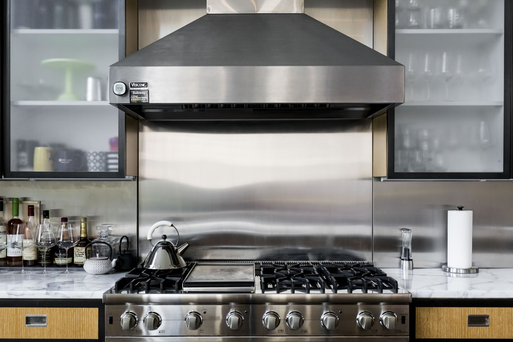 silver gas range oven with counter range