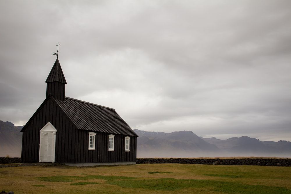 black church on plains during daytime