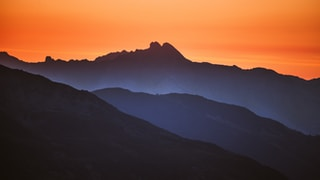 mountain silhouette during golden hour