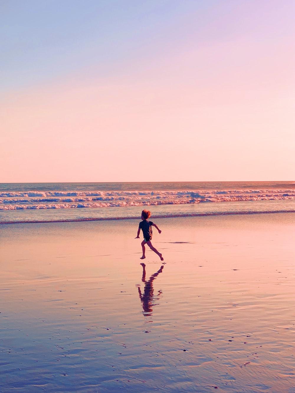 toddler runs on seashore