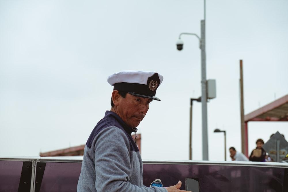 man wears white cap