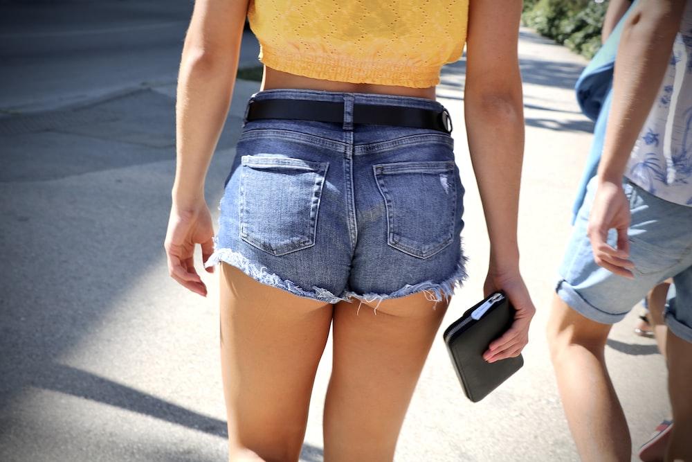woman wearing blue denim short shorts