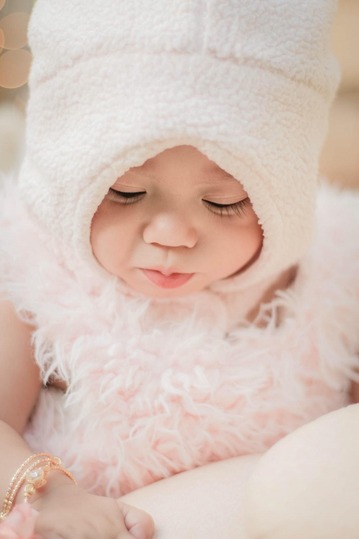 baby wearing white hat
