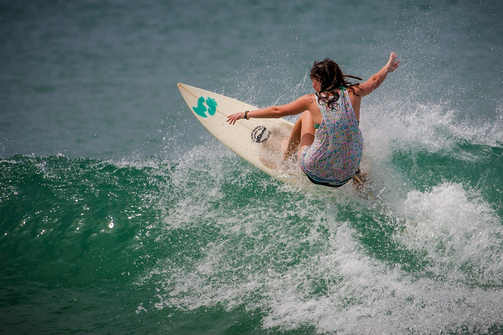 person surfboarding during daytime