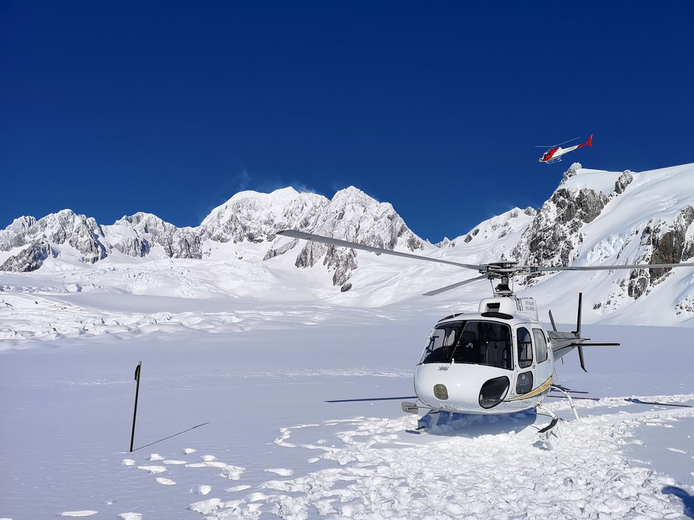white helicopter on ice field