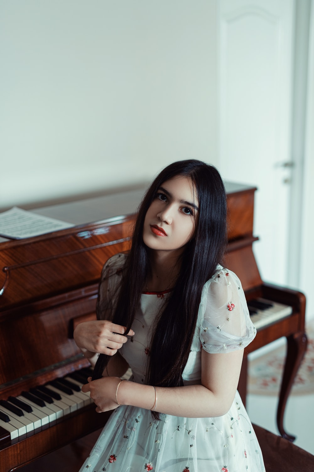 woman sitting by the piano