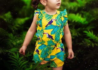 girl in yellow and green dress