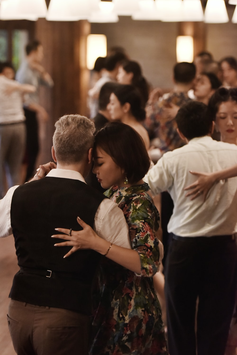 shallow focus photo of man and woman dancing