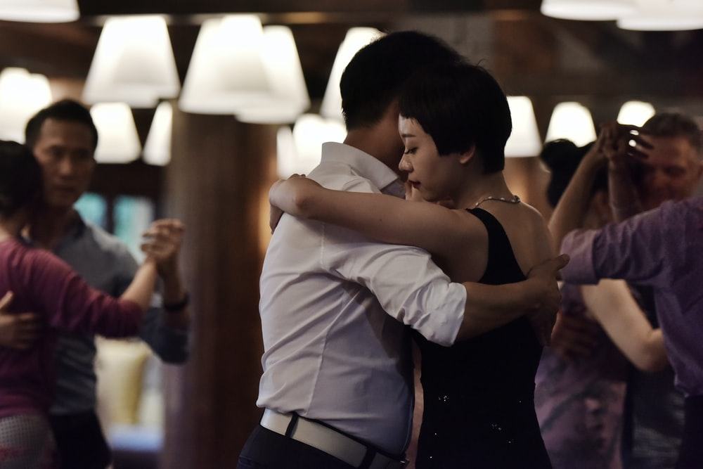 selective focus photography of couple dancing