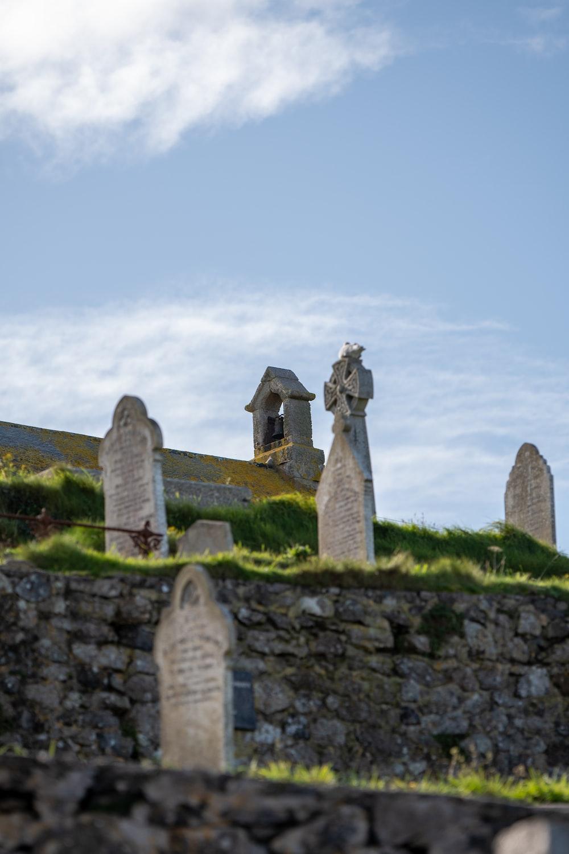 grey tombstones during daytime