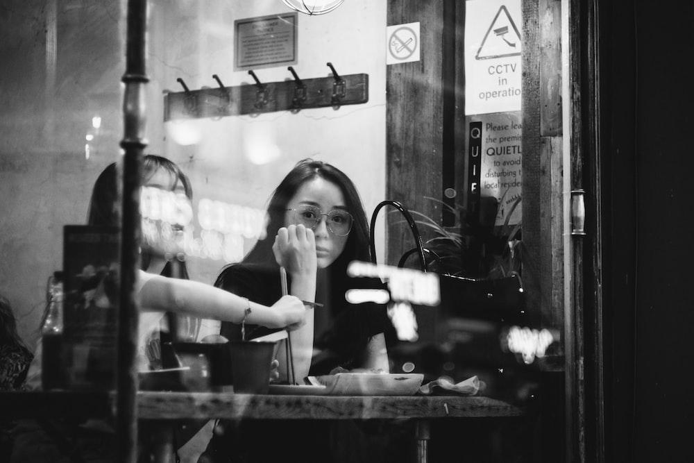 women behind glass panels