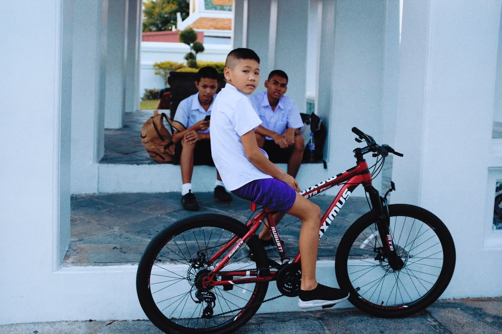 boy riding on bike