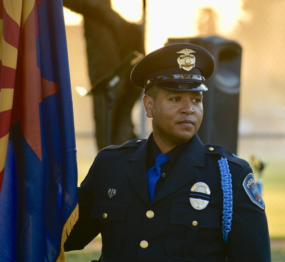 police officer standing near flag