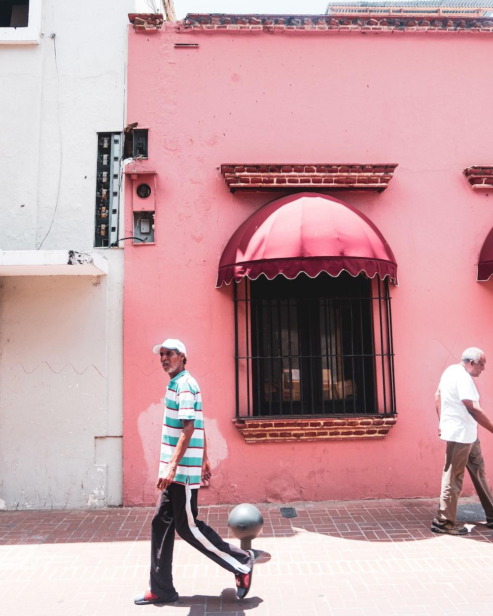 men walking beside street