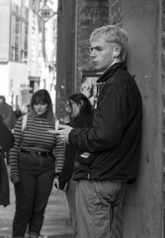 grayscale photography of people walking on pathway