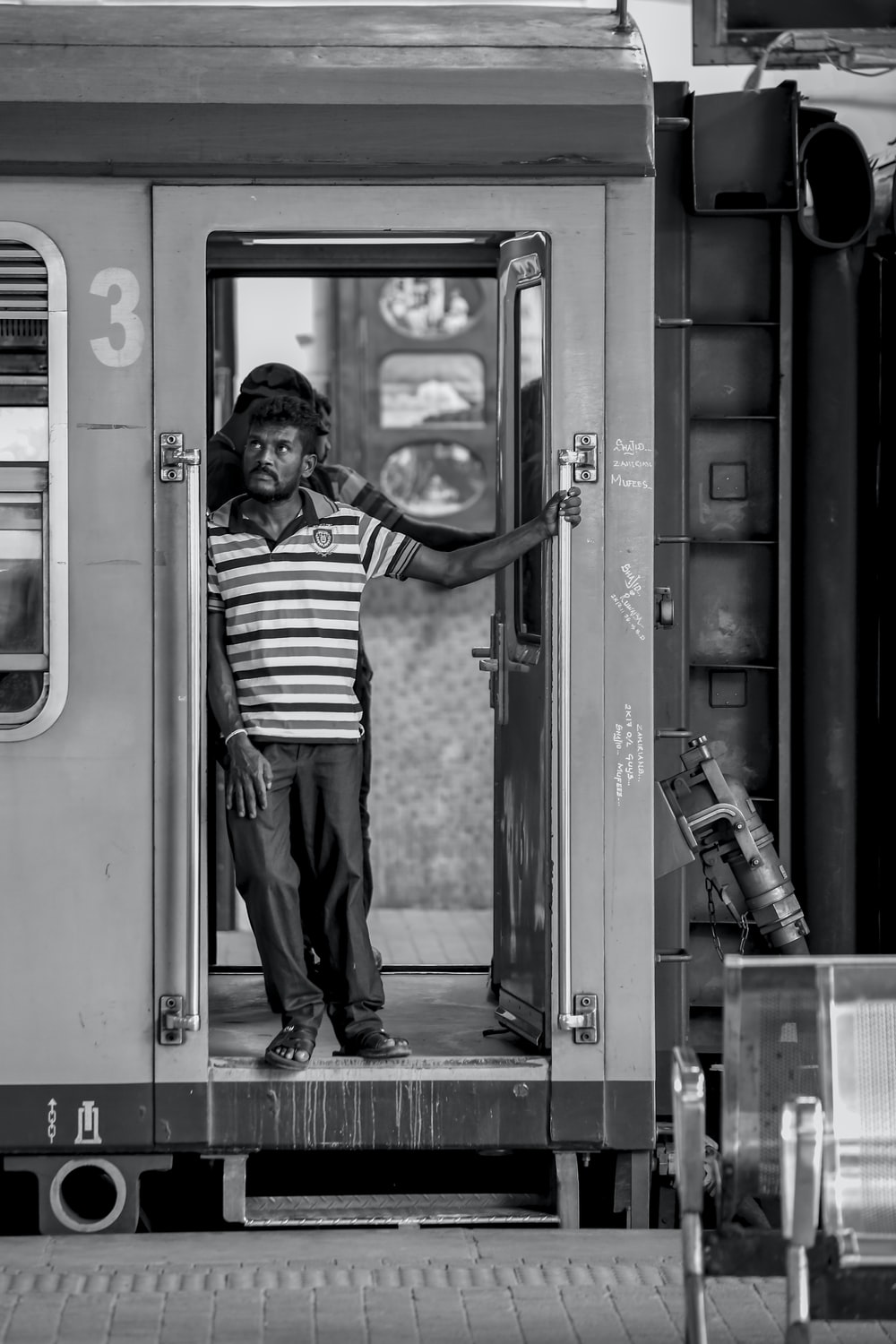 grayscale photography of man in train