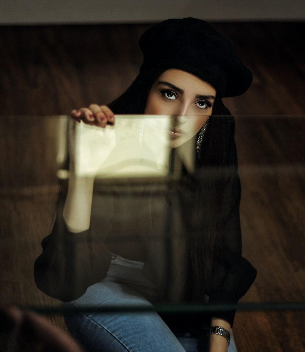 woman holding glass panel