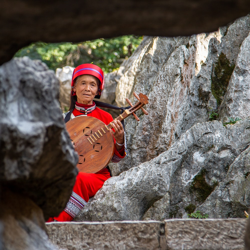woman playing traditional guitar