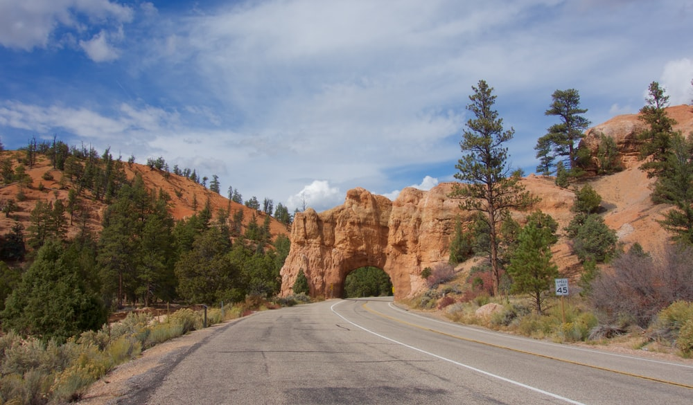 concrete road leading to a rocky mountain
