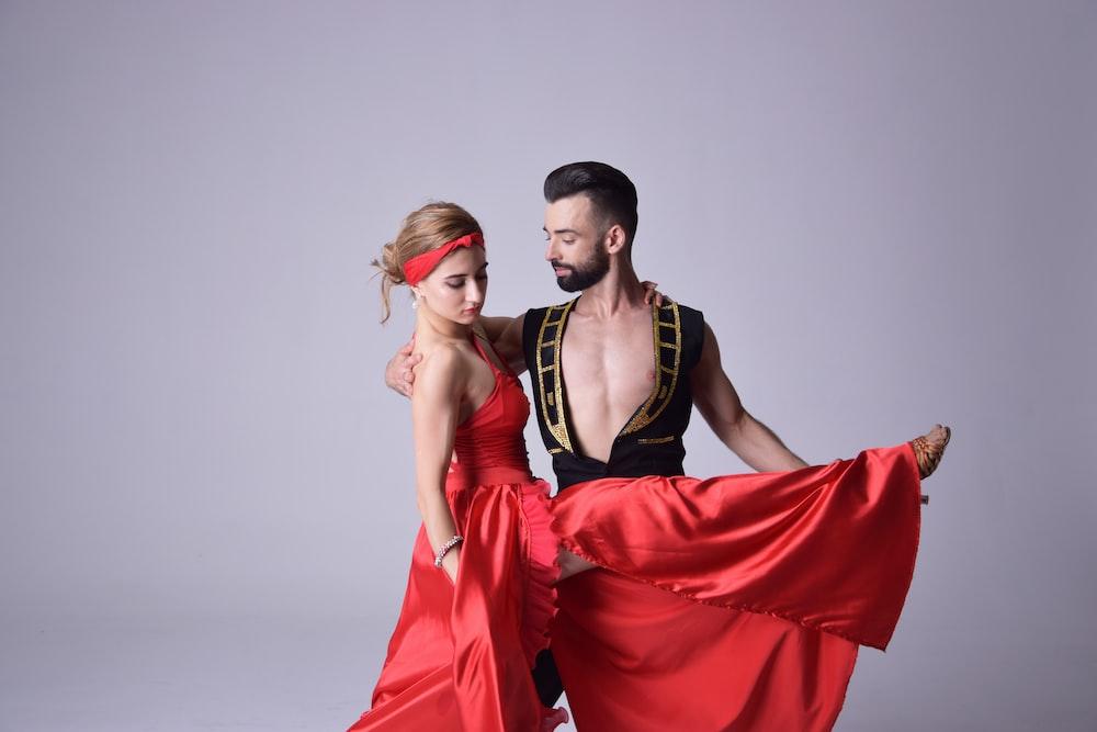 woman wearinf red dancing dress