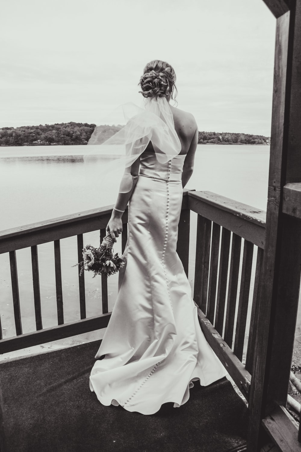 grayscale photography of bride