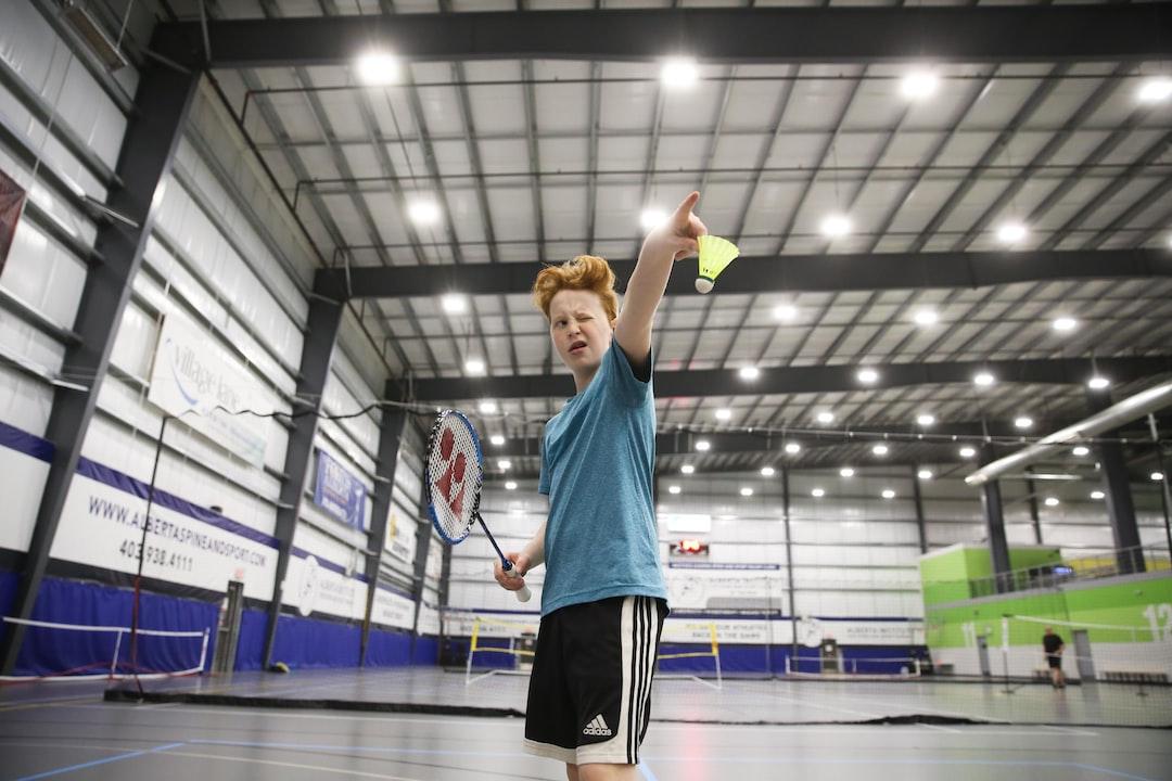 playing badminton, having fun playing a sport, calling the shot, badminton birdie, shuttle cock, badminton sport,
