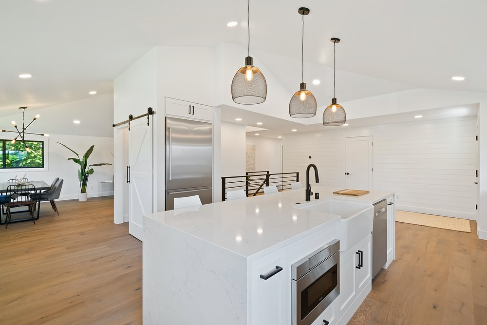 turned on pendant lamps above kitchen island