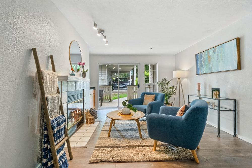 two blue sofa chairs inside house