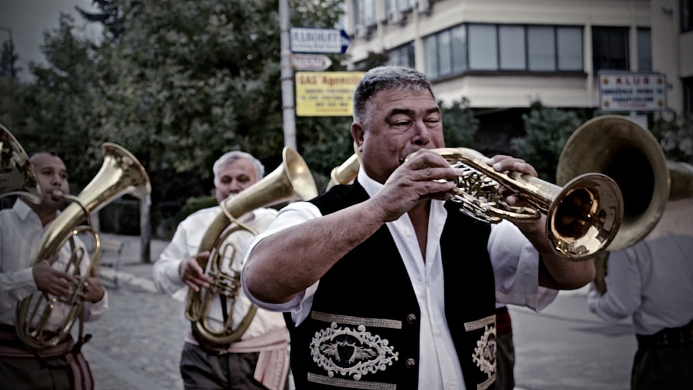 man playing wind instrument