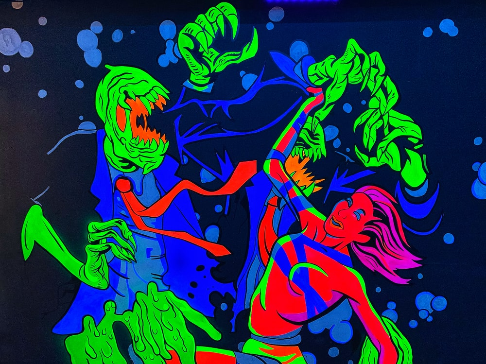 monster holding woman painting