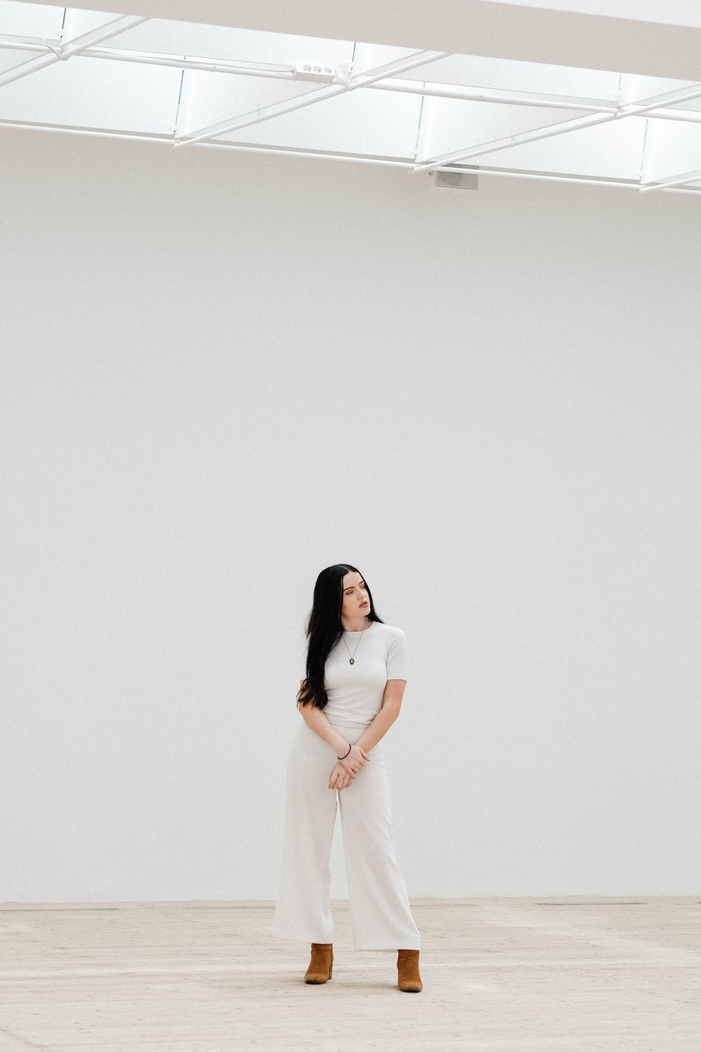 woman standing in front of white wall