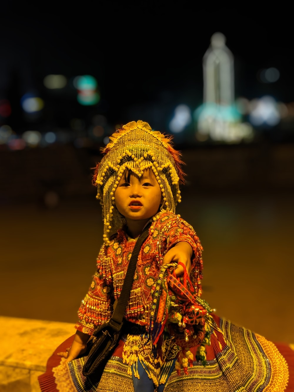 girl in multicolored traditional dress