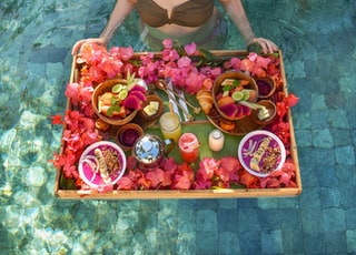 tray of fruits on pool