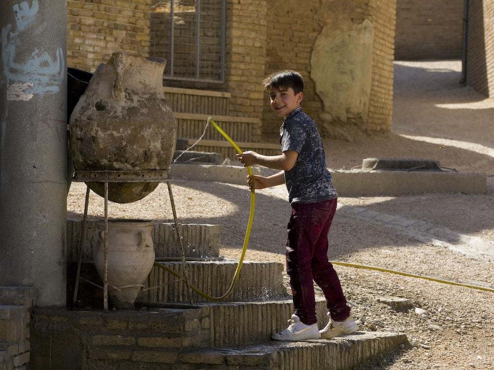 boy holding hose