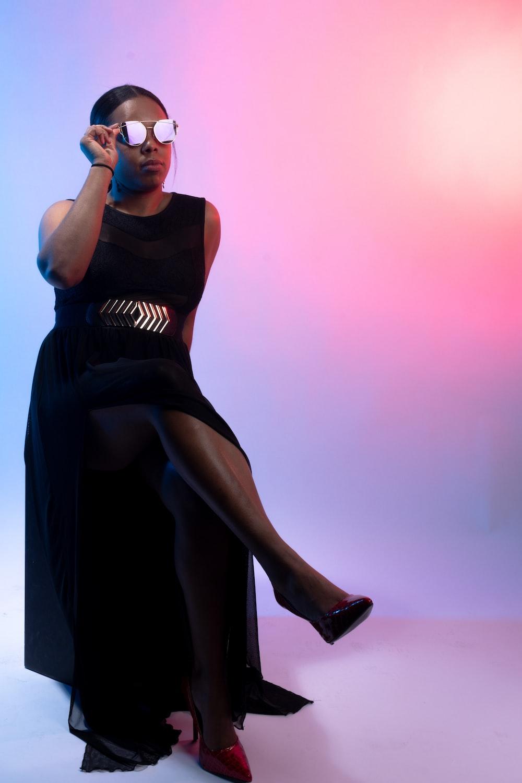 woman in black tank dress
