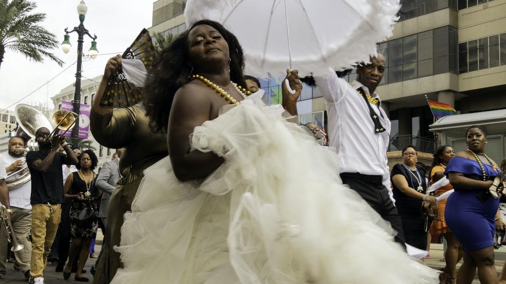 woman wearing white wedding dress during daytime