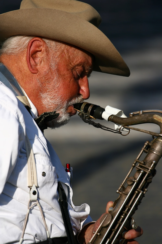 man plays wind instrument