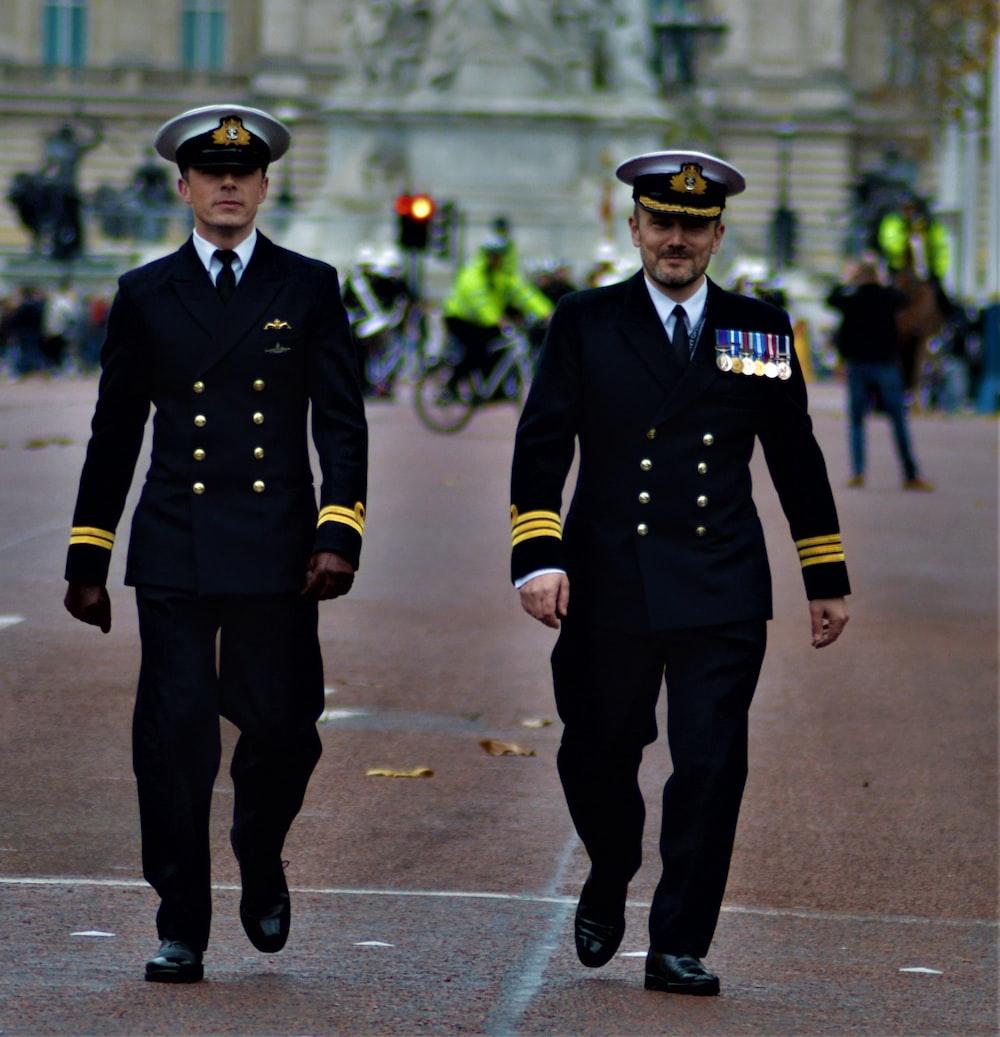 two men in uniform walking side by side