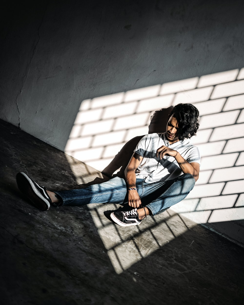 man sitting on wall