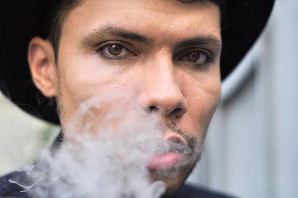 man smoking in macro photography