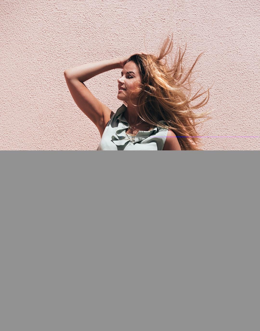 Beautiful woman with windy hair. It's summer in Portugal. Photo by Toni Hukkanen. Model: @anihukkanen