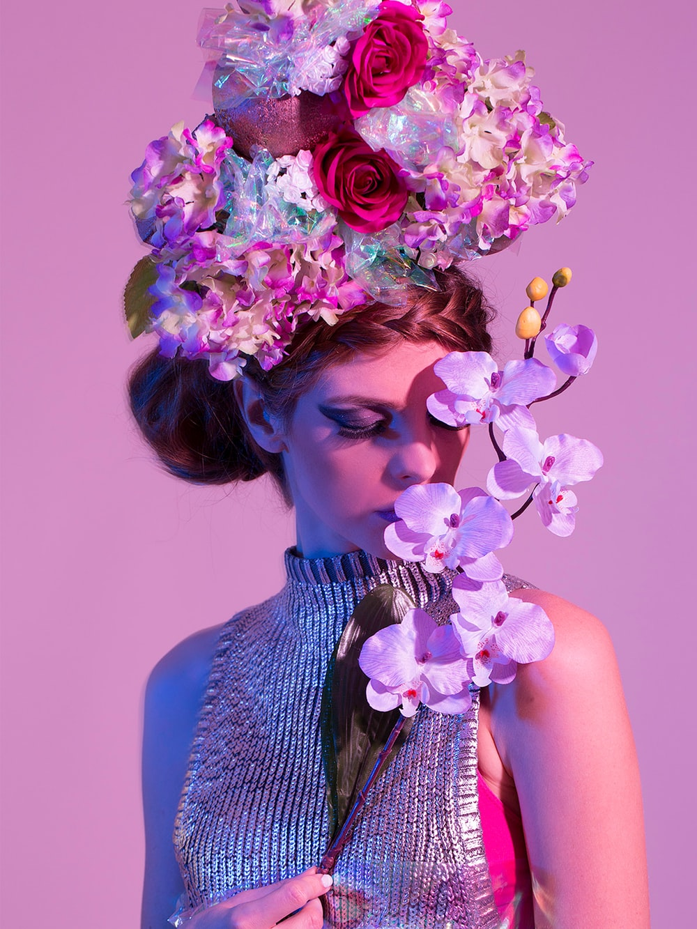 woman holding purple orchid flower