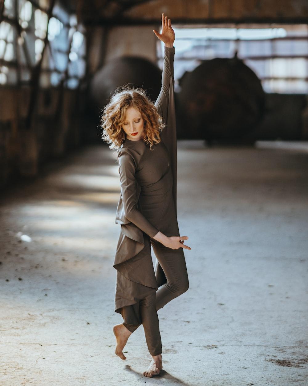 dancing woman wearing black dress