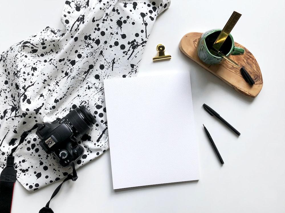 white paper beside camera
