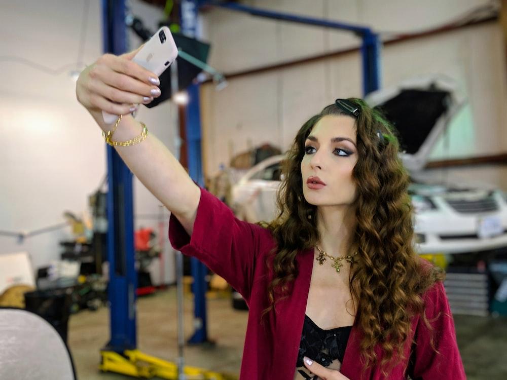 selective focus photo of woman taking selfie