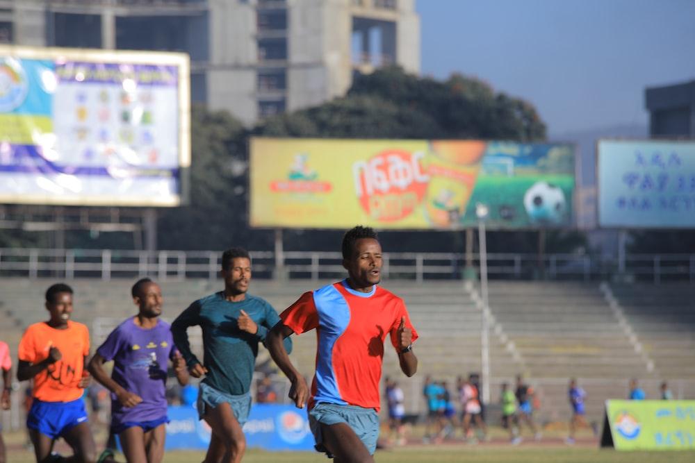 group of men running during daytime